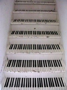 Really funky and fun way to do the stairs down to the basement/music room !! Super cheap and easy too!