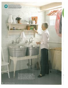 Love the converted galvanized tubs in the laundry as sinks.