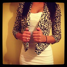 Leopard blazer high waisted black skirt or a white tee and jean skirt! Brown wedge ankle strap heels with and oo la la.