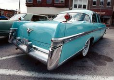 I'm a sucker for teal 1950s cars with fins. My Barbies had that car. Haha! <3