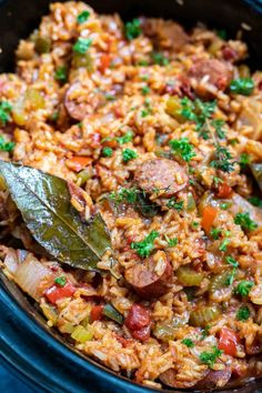 Celebrate Mardi Gras with this Chicken and Sausage Slow Cooker Jambalaya Recipe. A Cajun favorite made super easy right in your crockpot. A fun, flavorful and festive dinner idea.
