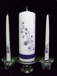 Put some sparkle in your special day with this unity candle set. I put some bling and sparkle lace on this set. I can do this in many different colors. Let me know what your colors are and I will try to match. Have fun on your day. White or ivory candle. Candle holders not included. Free