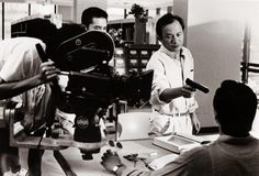 John Woo and Tony Leung (partially hidden) on the set of Hard Boiled (1992)