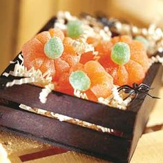 Provide orange and green gumdrops for kids to decorate shape these sugar-coated candy pumpkins.