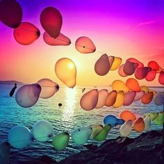 Balloons at Dusk. Technicolour! would be really cool for a beach party or wedding