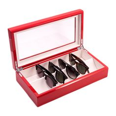 This elegant eyewear storage case offers a glass top for easily viewing up to eight of your glasses or sunglasses. It is crafted of a high quality lacquered wood in red or white.