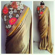 Gorgeous gold silk cocktail sari with floral embroidery blouse....