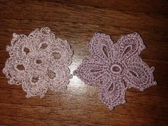 Two padded Irish lace pieces (made on the train ride to Hull) - Pattern in: The Go-to Book for Irish Crochet Motifs http://www.amazon.co.uk/gp/product/1596359234