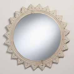 Hand-carved petals with a burnt whitewash finish radiate out from our round mirror, a brilliant addition to any room.