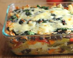 Roasted Veggie Enchilada Casserole, layers of roasted vegetables, salsa verde, whole wheat tortillas and fresh spinach with a little cheese. Make one for dinner, another for the freezer.