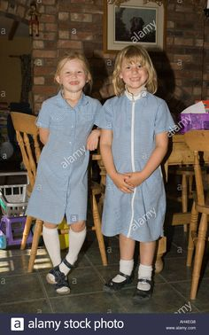 two-young-primary-6-year-old-school-children-at-home-in-school-uniforms-AH4EG8.jpg (866×1390)