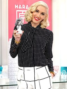 The Voice mentor Gwen Stefani promotes her new collection of fragrances, Harajuku Lovers Pop Electric, during an HSN launch on Thursday in St. Petersburg, Florida.