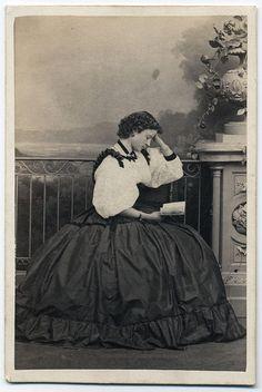 Young woman reading - short hair