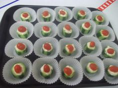 Super easy cucumber bites Cut english cucumbers into 1.5 inch high pieces ,scoop out seeds with a melon baller,add herb and garlic cream cheese to the center top with half a cherry tomato serve in a muffin liner cup done...