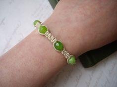 Hemp macrame bracelet by Roads Less Traveled. #jewelry #bracelet #green #beads #macrame