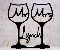 Wedding Cake Topper Mr. and Mrs. inside toasting wine glasses with your last name on Etsy, $32.50
