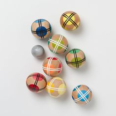 I love the look of this small handmade wooden bocce set... But ummm $300, I don't think so. I made my own by buying a pack of 10 hardwood balls from a local woodworking store and painted them myself. The whole project cost me less than $20. Now that's what I'm talking about