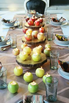 It only takes a few apples and a bag of Pier 1 tealights to add a harvest feel to your table. Find this idea and other creative DIY tips for your Thanksgiving dinner at the Little Green Notebook blog.