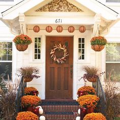 I have always loved the look of pumpkins onthe front porch! Would you like to see my collection of yummy autumnal front porch inspiration? (Let's pretend you said yes!) Here are twenty-two fall front porch ideas for you.Click on the link underneath each picture