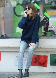 Alexa Chung is the reigning queen of effortless fashion. This outfit is simple and suitable for anyone. A large sweater, ankle grazers, huge sunnies, and chelsea boots are all you need. This look is very open to interpretation - wear a bright sweater, printed sock, or statement bag to personalize it.