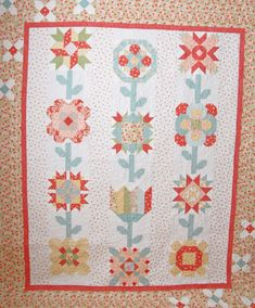 pretty by hand mystery block of the month quilt FQS [what a neat way to join sampler blocks! *T]