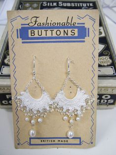 Vintage Lace earrings. Handmade lace handsitched with silver wire and finished with pearls  www.judithbrownjewellery.co.uk