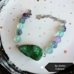 Bracelet with a druzy agate link and fluorite beads. 💚💜💚 Find us on Facebook! #handmade #bracelet #purplebracelet #green #unique #uniquejewellery #AtelierCubique #madeinromania Pandora Charms, Agate, Unique Jewelry, Facebook, Beads, Link, Bracelets, Green, How To Make