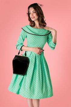 cbc8ed1ed4ff This 50s Ice Coffee Polkadot Swing Dress in Mint has bags of vintage  appeal! This