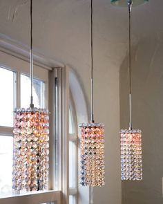Remodeling a Galley Kitchen: I like how 3 sparkly lights add modern interest to a traditional galley kitchen