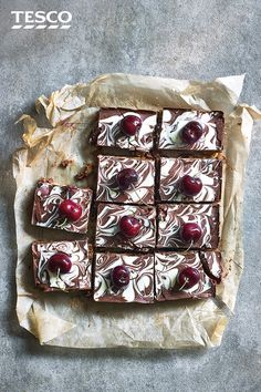 Enjoy this no-bake, homemade traybake recipe. Made with juicy cherries, crushed ginger nut biscuits and creamy milk chocolate, this easy chocolate tiffin recipe is the perfect picnic idea. See more Tiffin recipes at Tesco Real Food. White Chocolate Brownies, Chocolate Souffle, White Chocolate Chip Cookies, Chocolate Cherry, Tray Bake Recipes, Easy Baking Recipes, Cake Recipes, Chocolate Tiffin Recipe, Ginger Nut Biscuits