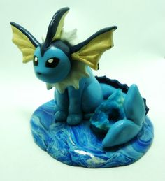 """POKEMON Vaporeon- A 3.5"""" polymer clay sculpture with blue geode stone."""