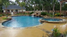 Poolandspa.com - Tropical Swimming Pool with Spillover Spa