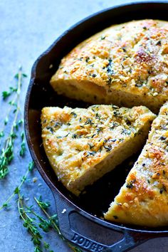 The dough for this soft, authentic Parmesan herb foccacia is made the night before and no kneading required! You won't believe how much amazing flavor develops in the dough overnight.