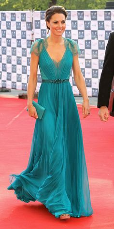 For an Olympic-themed concert at the Royal Albert Hall in London in May of 2012, the royal wore a teal, lace-trimmed Jenny Packham gown with a jeweled waistline from the designer's spring 2012 collection. She paired the look with a matching clutch and Jimmy Choo heels.