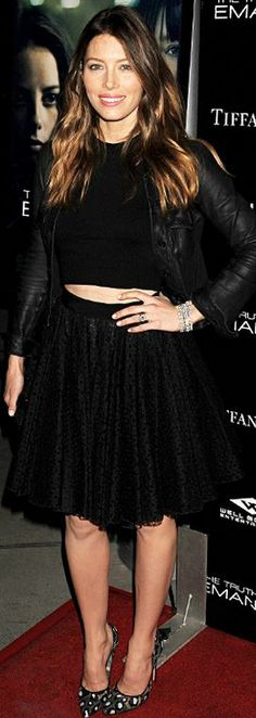 Who made  Jessica Biel's flare skirt, black cropped top, jewelry, black leather jacket, and lace pumps that she wore in Los Angeles on December 4, 2013?
