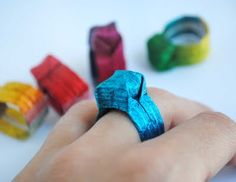 When I was a kid we used to do that with candi paper... Origami ring tutorial