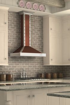 Remodel your kitchen with the  ZLINE KB2-CSSXS designer wall mount copper range hood, perfect with white kitchen cabinets. It has a shiny copper exterior & chimney. Stainless steel crown molding, front & side bands & stainless steel buttons. This hood comes in sizes 30 & 36 inches & includes 2 directional LED lights, backdraft damper to round ducting, high performance 760 CFM/4-speed. Purchase today at www.therangehoodstore.com
