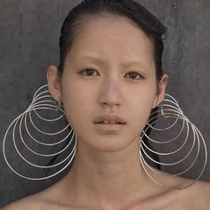 No info on these earrings which seem more installation then jewellery. But supercool.