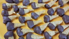 Chocolate Dipped Peanut Butter Bugles. Try different color wafers to melt to create different colors on the ends to enjoy the holidays instead of using chocolate.
