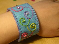 Embroidered felt cuff