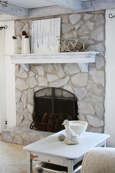 AMAZING tutorial on painting a dark stone fireplace to look naturally rustic... This will be my fireplace inspiration! erin's art and gardens: painted stone fireplace before and after by elizabeth
