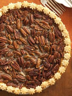 BROWN SUGAR PECAN PIE Brown sugar and maple syrup drenched pecans are the sweet and sticky filling for this perfect holiday pie. #Thanksgiving #holiday #pie #dessert #recipe