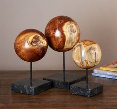 Interlude Sambas Spheres. This trio of wood spheres make a warm, eye-catching accessory when displayed together. Item is made from natural teak root. By nature, no two pieces are identical. Coloration will vary. – Modish Store