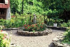 Stone raised beds and pebble paths in rustic garden—Jon Carloftis Fine Gardens