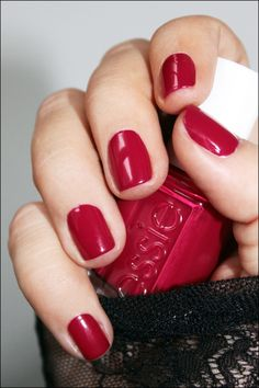 ESSIE nail polish in the color Size Matters, a perfect blue red just a tad deeper than medium in tone.