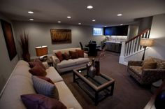 Basements usually have the least lighting outlets available. But ceiling light outlets are more common. Install a pair of track lights parallel with each other and perpendicular to the length of the basement for equal lighting to reach everywhere. old-furniture-basement