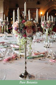 Romantic candelabra centrepieces for a castle wedding in Warwickshire. Candelabra Wedding Centerpieces, Candelabra Flowers, Candlestick Centerpiece, Floral Centerpieces, Centrepiece Ideas, Romantic Wedding Receptions, Wedding Reception Flowers, Wedding Reception Decorations, Wedding Ideas