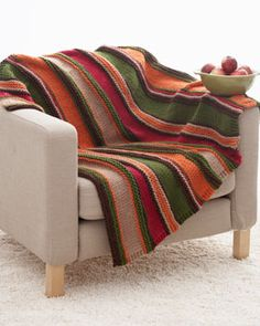 Bright and bold stripes add serious style to this simple blanket. Shown in Bernat Softee Chunky.