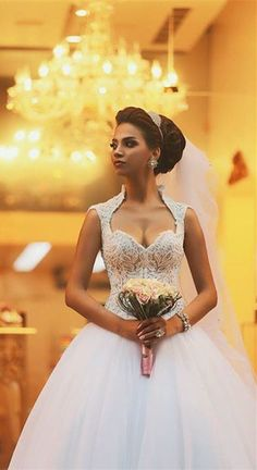 How about this beaded lace tulle princess wedding dress for a really romantic wedding ceremony? www.27dress.com