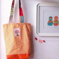 sharonruhmanworks's photo: #totebag made of picnic orange cotton, vinyl bottom, patchwork straps.